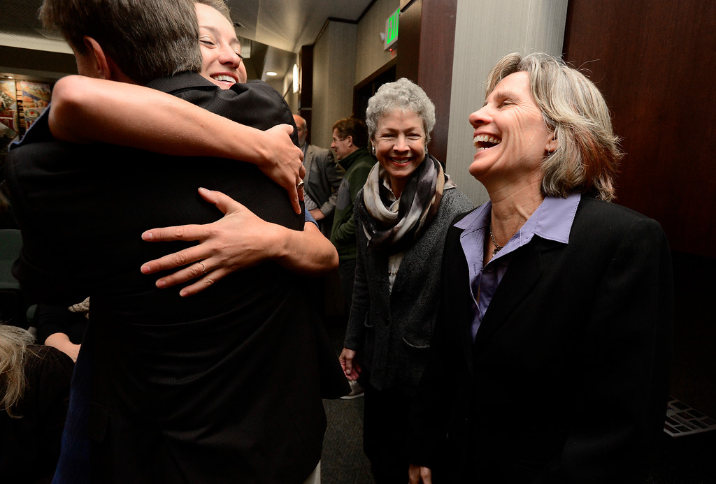 . Jill Adler Grano hugs Sam Weaver as Cindy Carlisle and Suzanne Jones at right laugh during the swearing in of Boulder City Council members elected or re-elected in the last election during a ceremony in the Boulder City Council Chambers in the city municipal building on Tuesday morning.  For more photos go to dailycamera.com Paul Aiken Staff Photographer Nov 21, 2017