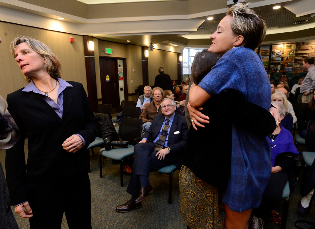 . Jill Adler Grano hugs Lisa Morzel as Suzanne Jones at right tries to get candidates lined up for a group photo during the swearing in of Boulder City Council members elected or re-elected in the last election in a ceremony in the Boulder City Council Chambers in the city municipal building on Tuesday morning.  For more photos go to dailycamera.com Paul Aiken Staff Photographer Nov 21, 2017