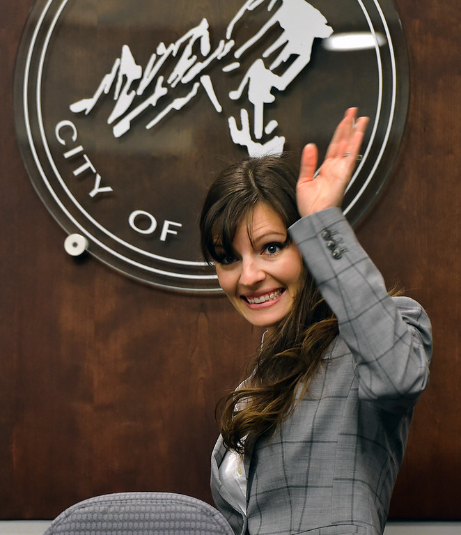 . Mirabai Kuk Nagle waves to the crowd from the city council seating area during the swearing in of Boulder City Council members elected or re-elected in the las election during a ceremony in the Boulder City Council Chambers in the city municipal building on Tuesday morning.  For more photos go to dailycamera.com Paul Aiken Staff Photographer Nov 21, 2017