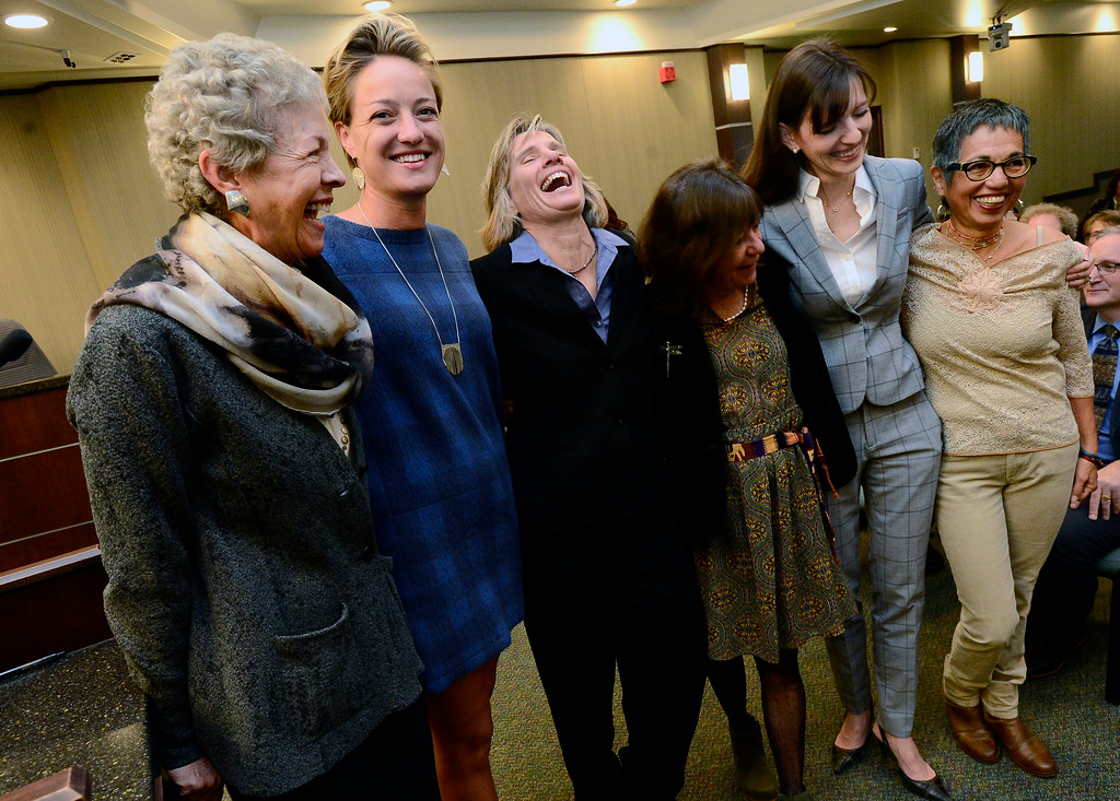 . From left to right Cindy Carlise, Jill Adler Grano, Suzanne Jones, Lisa Morzel, Mirabai Kuk Nagle, and Mary Young join for a women\'s group photo during the swearing in of Boulder City Council members elected or re-elected in the las election during a ceremony in the Boulder City Council Chambers in the city municipal building on Tuesday morning.  For more photos go to dailycamera.com Paul Aiken Staff Photographer Nov 21, 2017