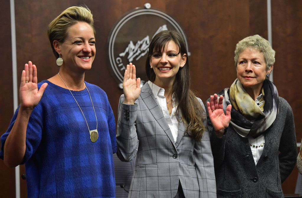 . From left to right new Boulder City Council members Jill Adler Grano, Mirabai Kuk Nagle, and Cindy Carlise, at right, get sworn during a ceremony in the Boulder City Council Chambers in the city municipal building on Tuesday morning.  For more photos go to dailycamera.com Paul Aiken Staff Photographer Nov 21, 2017