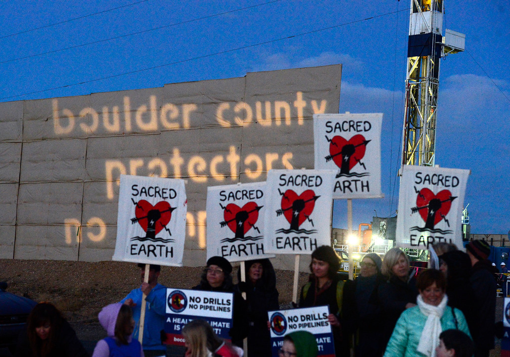 . The Boulder County Protectors protest against a well in Weld County on Friday.  For more photos and video go to dailycamera.com. Paul Aiken Staff Photographer December 12 2017.
