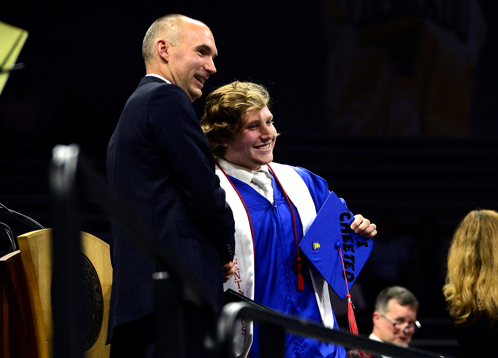 . Zach Hyman has his photo taken with principle Daniel Ryan during the Centaurus High School Commencement at Coors Events Center on CU Boulder Campus on Saturday. For more photos go to dailycamera.com. Paul Aiken Staff Photographer
