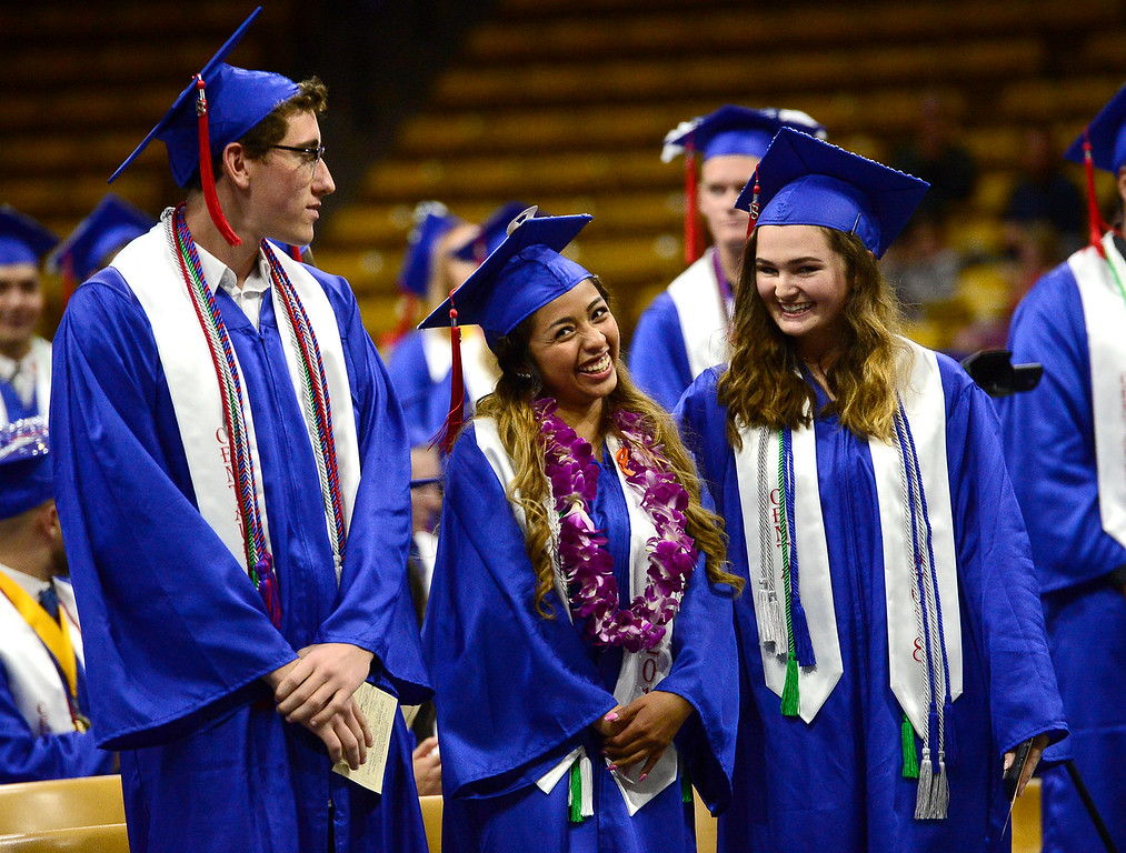 . From left to right, Tobias Rubenfeld, Ximena Silva and Katherine Strohl, are some of the students asked to stand and be recognized for their academic achievements during the Centaurus High School Commencement at Coors Events Center on CU Boulder Campus on Saturday. For more photos go to dailycamera.com. Paul Aiken Staff Photographer