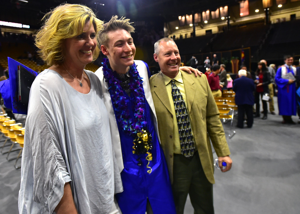 . Anne and John Kemp pose with their graduate son Tyler after the Centaurus High School Commencement at Coors Events Center on CU Boulder Campus on Saturday. For more photos go to dailycamera.com. Paul Aiken Staff Photographer