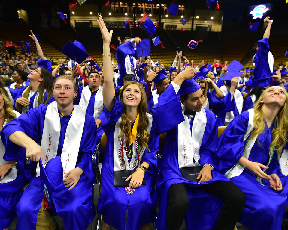 . From left to right Blake Doiron, Oliva Fase and Ernesto Flores join in in the cap throwing after the Commencement ceremonies at Coors Events Center on CU Boulder Campus on Saturday. For more photos go to dailycamera.com. Paul Aiken Staff Photographer