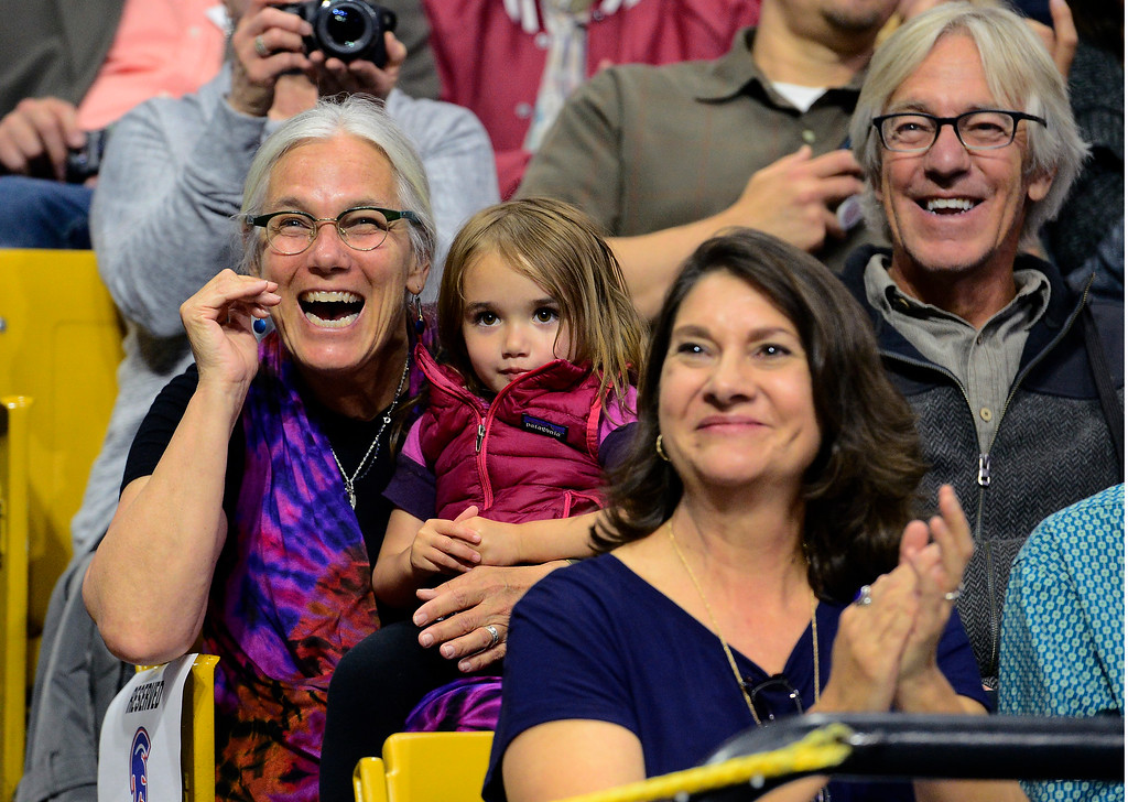 . Ann Mitchell cheers on her graduate daughter Mia Belting while holding her niece Scout Gallegos during the Centaurus High School Commencement at Coors Events Center on CU Boulder Campus on Saturday. For more photos go to dailycamera.com. Paul Aiken Staff Photographer