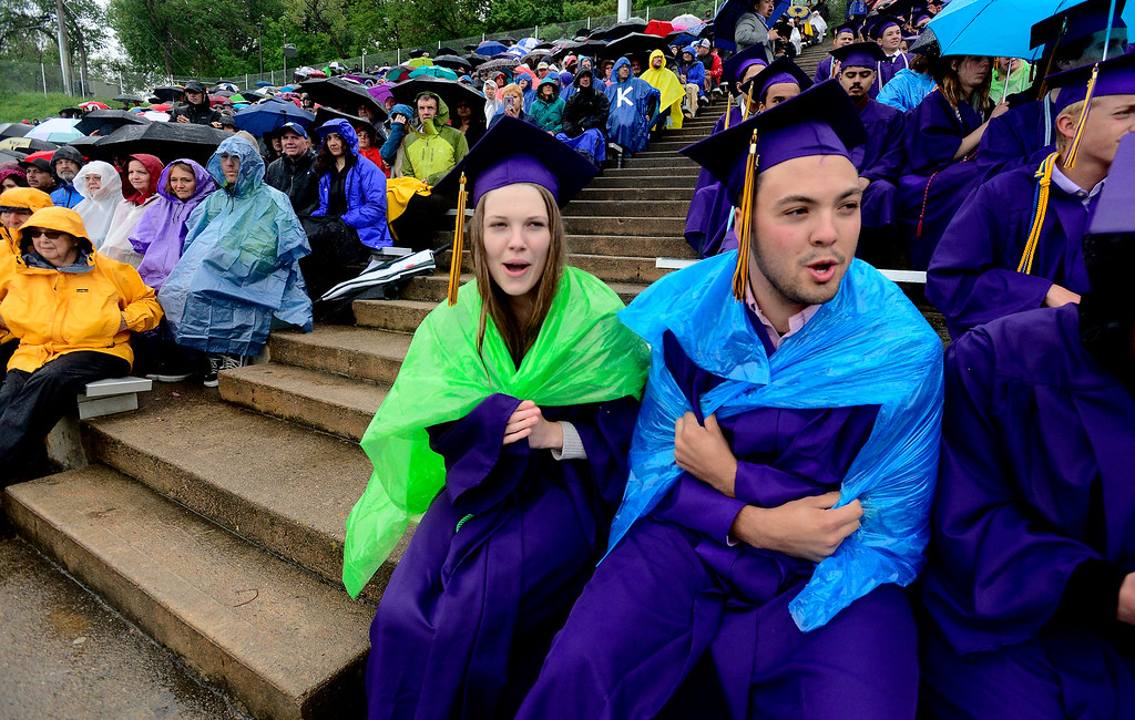 . Campbell Breithaupt, left, and Jack Braymiller, cheer for their classmates at the Boulder High School Commencement on Recht Field on Saturday. For more photos go to dailycamera.com. Paul Aiken Staff Photographer