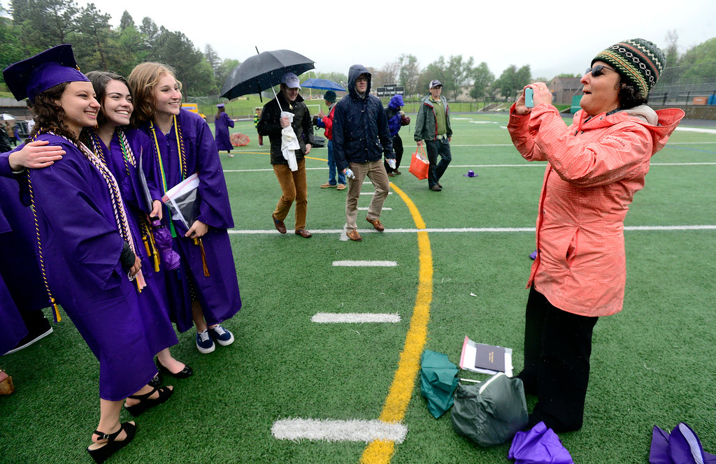 . From left to right Avivah Malin, Alysa Rogers and Julia O\'Keeffe get a group photo taken by Avivah\'s mother Diana Lane at the end of the Boulder High School Commencement on Recht Field on Saturday. For more photos go to dailycamera.com. Paul Aiken Staff Photographer