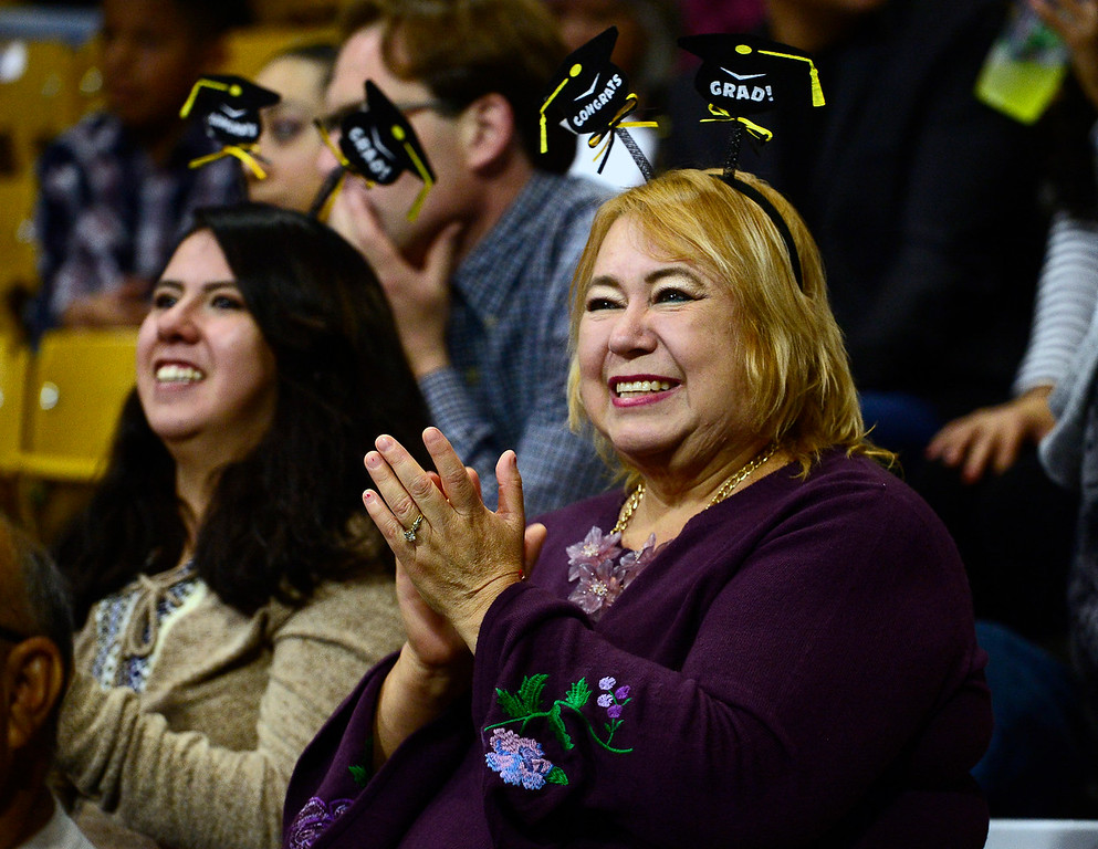 . Sarahi Salcido, left, and Maria Antonez cheer on their relative Araceli Silva Antunez, a graduate at the Centaurus High School Commencement at Coors Events Center on CU Boulder Campus on Saturday. For more photos go to dailycamera.com. Paul Aiken Staff Photographer