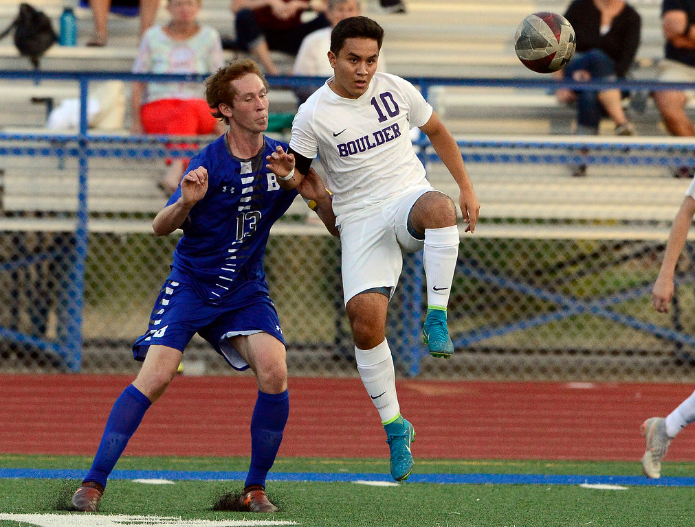 . BROOMFIELD, CO - SEPTEMBER 17 2018 Boulder High\'s Omar Castruita passes away from Broomfield High\'s Tanner Smith during their soccer game in Broomfield on Monday September 17, 2018. More photos Bocopreps.com  (Photo by Paul Aiken/Staff Photographer)