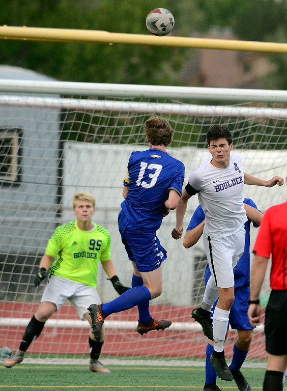 . BROOMFIELD, CO - SEPTEMBER 17 2018 Boulder High\'s Ian McDiamid-Sterling and Broomfield High\'s Tanner Smith fight in front of the net during their soccer game in Broomfield on Monday September 17, 2018. More photos Bocopreps.com  (Photo by Paul Aiken/Staff Photographer)