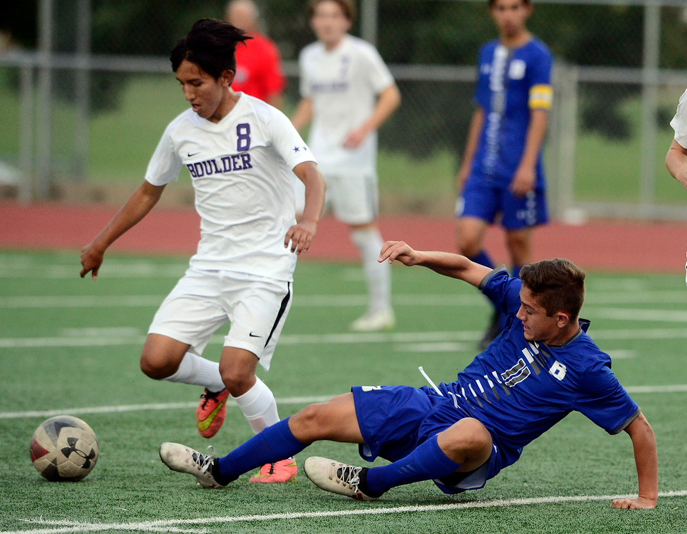 . BROOMFIELD, CO - SEPTEMBER 17 2018 Boulder High\'s Daniel Zapatero tries to control the ball as Broomfield High\'s Andrew Boettcher defends during their soccer game in Broomfield on Monday September 17, 2018. More photos Bocopreps.com  (Photo by Paul Aiken/Staff Photographer)