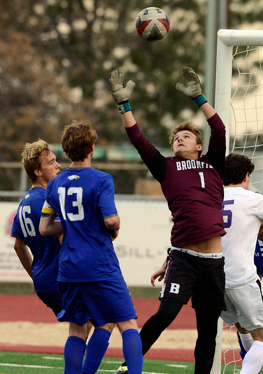 . BROOMFIELD, CO - SEPTEMBER 17 2018 Broomfield High\'s Kaden Carson grabs a loose ball against Boulder High\'s Kenneth Jew and Max Newmann during their soccer game in Broomfield on Monday September 17, 2018. More photos Bocopreps.com  (Photo by Paul Aiken/Staff Photographer)