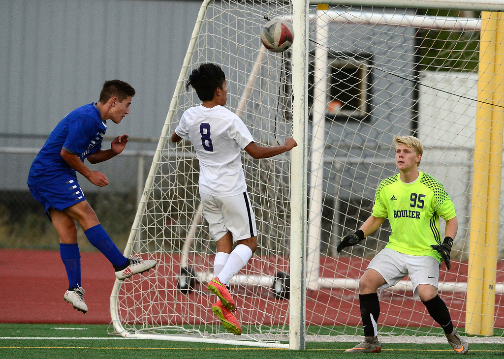 . BROOMFIELD, CO - SEPTEMBER 17 2018 Boulder High\'s Goalkeeper Toby Bateman and defender Daniel Zapatero defend against a header by Broomfield High\'s Andrew Boettcher during their soccer game in Broomfield on Monday September 17, 2018. More photos Bocopreps.com  (Photo by Paul Aiken/Staff Photographer)
