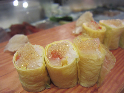 Salmon and shrimp roll with cod roe and egg wrapper