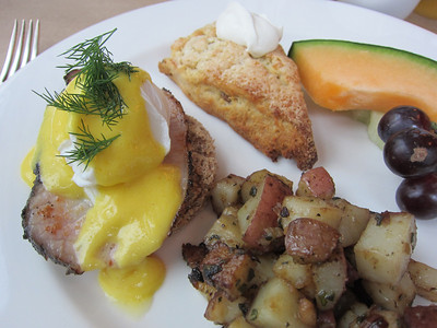Eggs Benedict with local eggs, house alder smoked pork loin, shallot potatoes and a scone