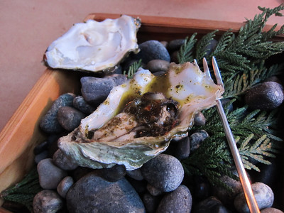 Grilled oyster with tequila and sage brown butter sauce