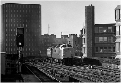 "Crossing Dean Street Viaduct, 55009 ""Alycidon"" approaches Manors Station on the 0550 Kings Cross-Aberdeen. The eagle-eyed may notice the Haverton Hill-Leith Ammonia tanks behind the passenger on the slow lines. This was not recorded?  22nd September 1979"