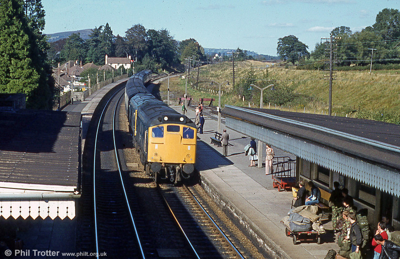 THE Class 25s never really excelled themselves on the 'North & West' route in the 1970s, reliability being a major issue.<br> A scene at Abergavenny when it was relatively safe for troops - on this occasion from Sennybridge - in uniform to travel by rail. <br>25061 leads failed 25055 into Abergavenny with the 1225 Crewe to Cardiff Central on 22nd September 1979.<br> Both locos were withdrawn from traffic in November 1980 and subsequently cut up at Swindon.