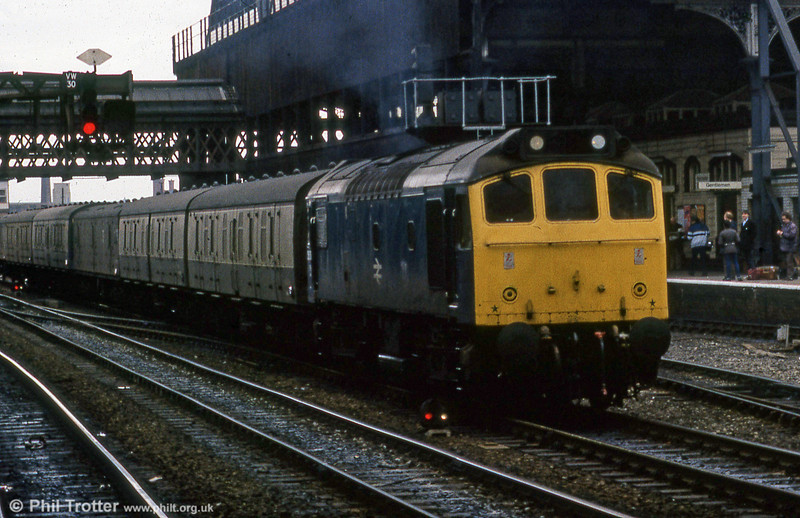 A class 25 leads a parcels train through the gloom of Manchester Victoria during 1980.
