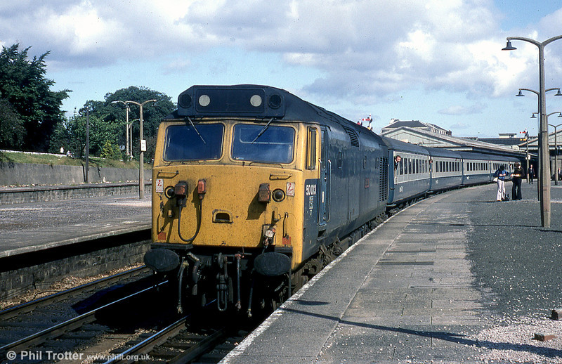 The flares, right, identify this photo of 50013 'Agincourt' at Newton Abbot on a summer Saturday train to the west, as having been taken in the 1970s; it is in fact 1979. The locomotive was scrapped in 1989.