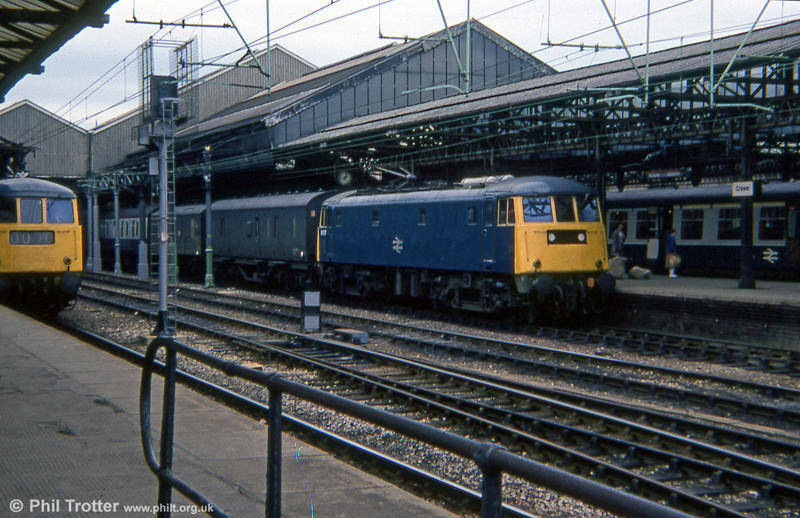 81012 calls at Crewe with a parcels train in 1978.