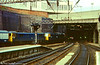 86245 is led out of Birmingham New Street by a class 47 in 1978.