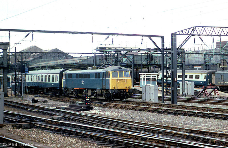 86214 departs from Crewe on 23rd July 1979.