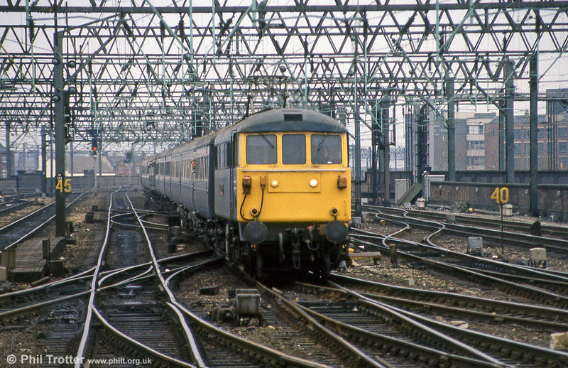 An unidentified class 86 heads a service from London Euston on the approach to Manchester Piccadilly.