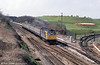 It's April 1985 and a class 33 speeds towards Bristol near Flax Bourton.