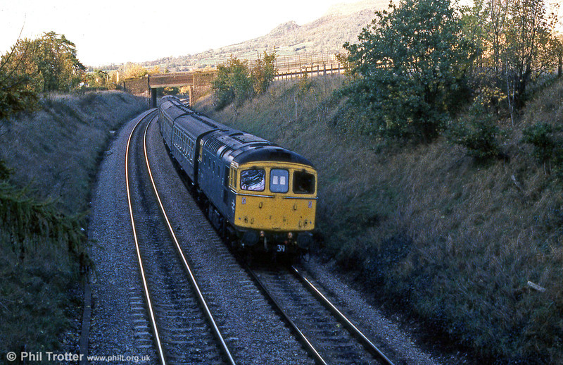 With the Skirrid Mountain as a backdrop, a class 33 approaches Abergavenny with a Crewe to Cardiff service.