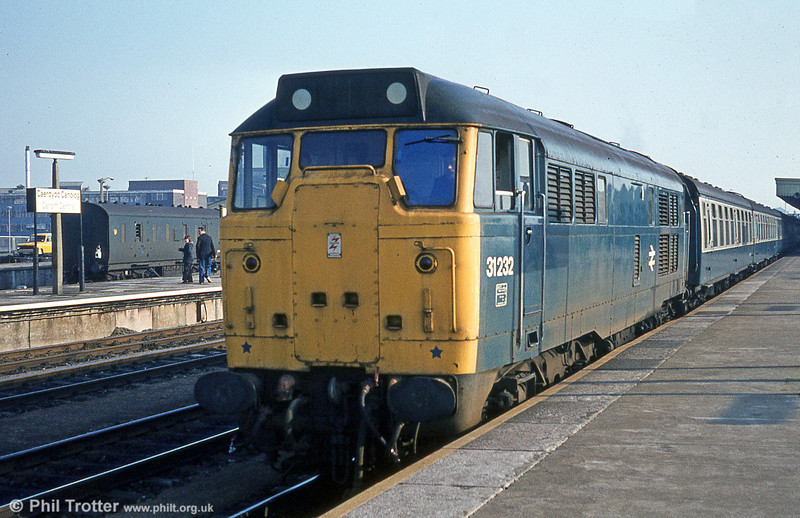 31232 waits at Cardiff Central, having arrived with 1V21, 0746 from Portsmouth Harbour on Valentine's Day, 1981. The loco had taken over the train at Bristol Temple Meads.