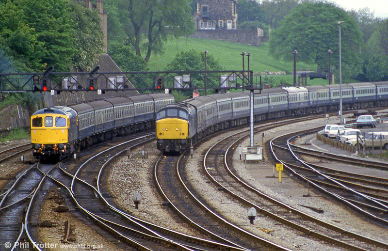 Representatives of classes 33 and 46 arrive simultaneously at Bristol Temple Meads in June 1985.