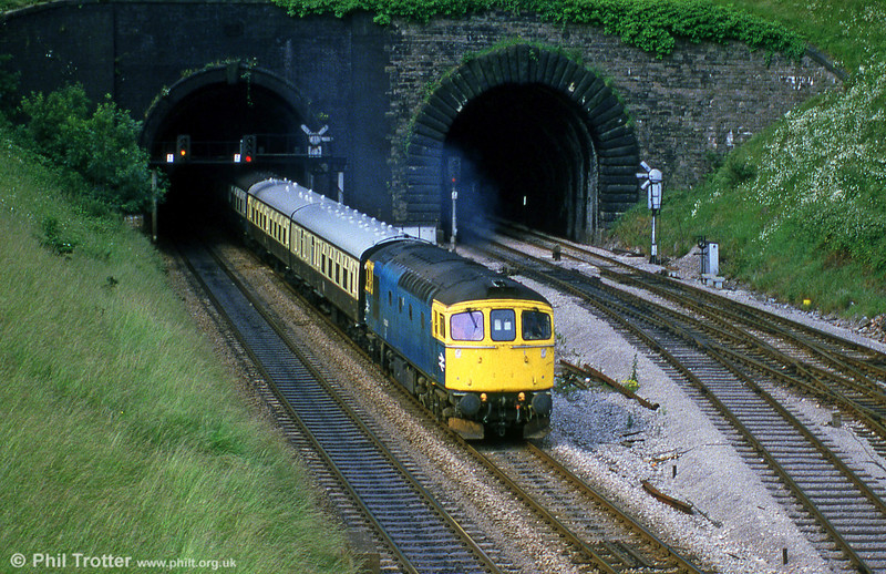A class 33 leaves the tunnels at Newport with a train of Mk1s in WR chocolate and cream livery, during July 1985.