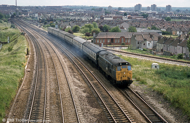 In four track days, a Portsmouth Harbour to Cardiff service, hauled by a class 31 at Narroways Hill Junction, Bristol. Stapleton Road station can be seen in the background.