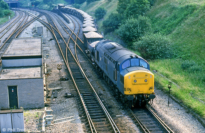 With the stalwart class 37s now all but extinct in South Wales, here's a flashback to happier times for the type. 37230 negotiates Gaer Junction, Newport with a ballast train from Machen Quarry in July 1985. 37230 was cut up at Booth's, Rotherham, in January 2006.