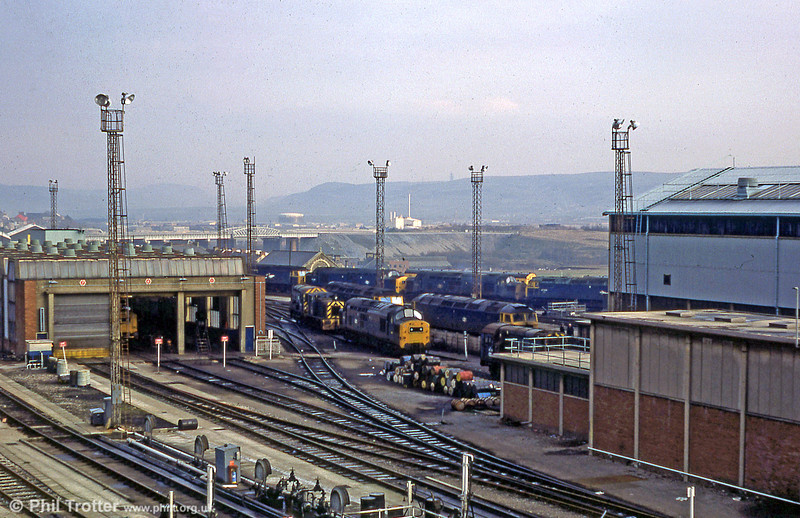 A view looking over Landore TMD with classes 37, 47, 03 and 08 on shed c.1979.