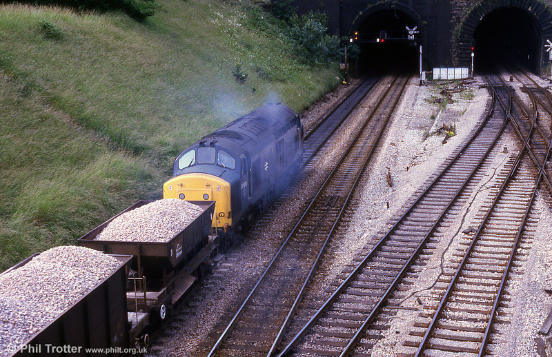 37230 approaches Newport Tunnels with a ballast train from Machen Quarry in July 1985.