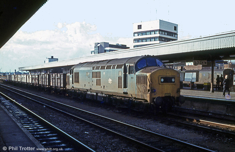 37275 passes through Cardiff Central with 21 ton coal wagons during 1979.