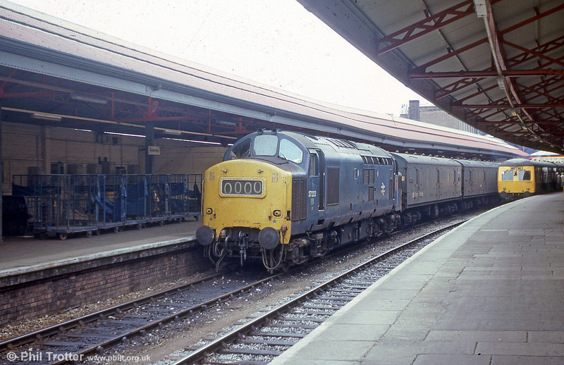 Against a backdrop of 'BRUTES', 37222 waits to leave Swansea with a parcels train on 30th July, 1979.