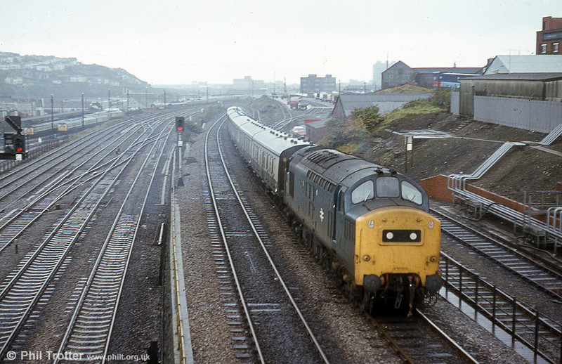 A class 37 heads a West Wales service through Swansea Loop East.