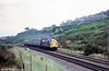 'Split headcode' 37107 climbs Cockett Bank with a West Wales train on 27th July, 1979.