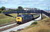 37191 and a weedkilling train on the Swansea avoiding Line at the back of Landore on 15th September, 1979.