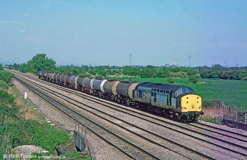 37711 at Coedkernew with 6V14, 0821 Hull to Baglan Bay on 13th May 1996.