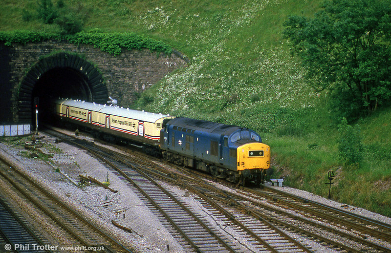 An unidentified class 37 emerges from Hillfield Tunnel, Newport with the GW150 exhibition train in July 1985.