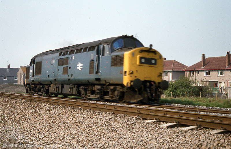 37192, one of the class 37s with a headlight fitted for working over the Central Wales Line, passes Pyle, c.1980.