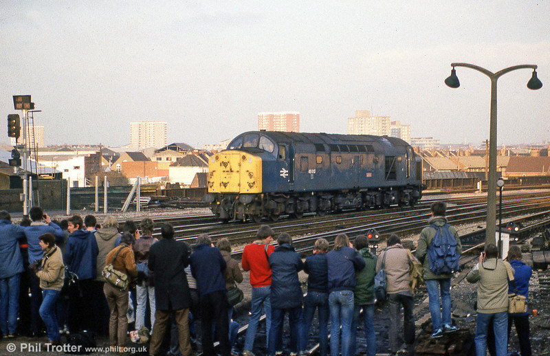 The class 40s had a huge following towards the end of their lives. 40012 'Aureol' attracts a large audience at Bristol Temple Meads as it backs onto its train for 'The Cornishman' to Leicester on 26th January 1985.