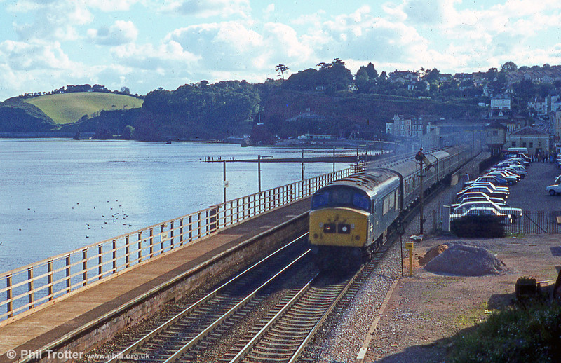 The sea is flat calm and the evening fishermen are on the slipway as this 'Peak' accelerates away from Dawlish c.1979.