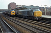 45059 'Royal Engineer' is passed by a class 37-hauled coal train at Newport.